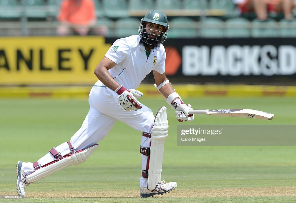 <a gi-track='captionPersonalityLinkClicked' href=/galleries/search?phrase=Hashim+Amla&family=editorial&specificpeople=647392 ng-click='$event.stopPropagation()'>Hashim Amla</a> of South Africa sets off for a run during day one of the second test match between South Africa and New Zealand at Axxess St Georges on January 11, 2013 in Port Elizabeth, South Africa.