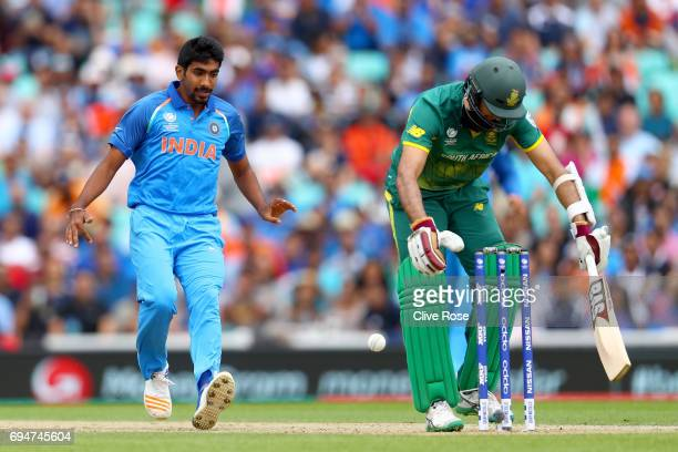 Hashim Amla of South Africa sheilds his stumps after playig the ball into the air as Jasprit Bumrah of India runs in to gather during the ICC...