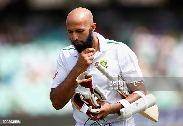 Hashim Amla of South Africa walks off after being caught behind during day two of the 1st Test between South Africa and England at Sahara Stadium...