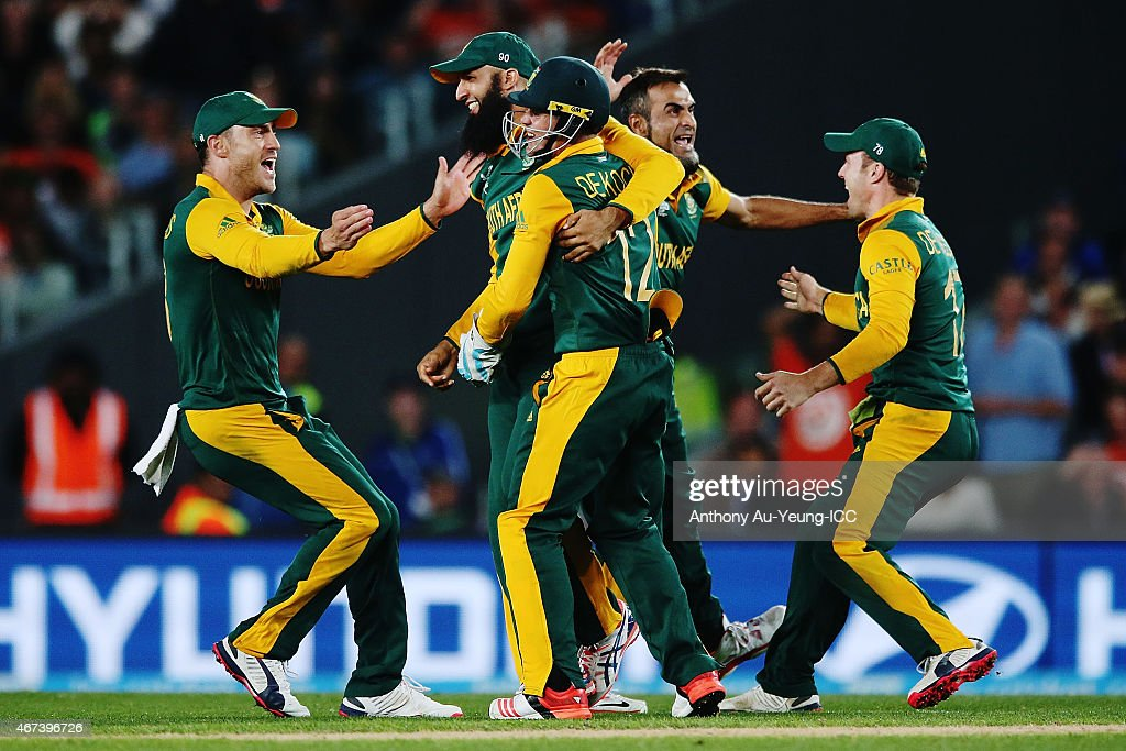 Hashim Amla, Quinton de Kock and Francois du Plessis of South Africa celebrate the runout of Martin Guptill of New Zealand during the 2015 Cricket World Cup Semi Final match between New Zealand and South Africa at Eden Park on March 24, 2015 in Auckland, New Zealand.