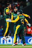 Hashim Amla Quinton de Kock and Imran Tahir of South Africa celebrate the runout of Martin Guptill of New Zealand during the 2015 Cricket World Cup...