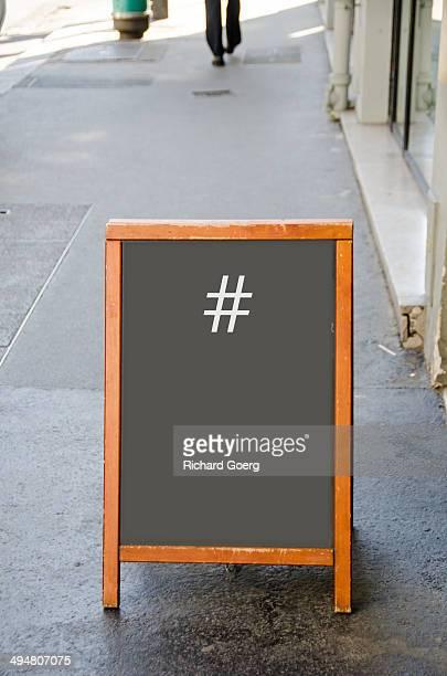 Hashtag on sidewalk sign