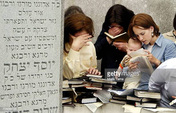 Hasidic Jewish women pray while visiting the grave of Rabbi Menachem Mendel Schneerson the seventh grand rebbe of the Lubavitch Hasidic movement at...