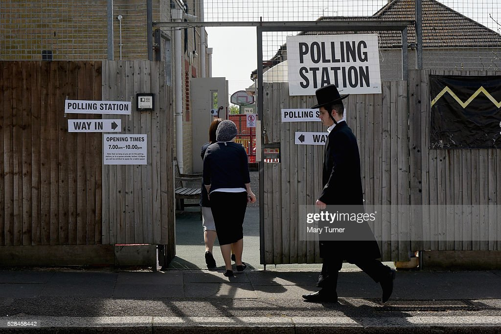 Hasidic Jews arrive at the Menorah Primary School, in Golders Green, North London to register their votes in the Mayoral and Assembly elections on May 5, 2016 in Golders Green, United Kingdom. Today, dubbed 'Super Thursday',sees the British public vote in countrywide elections to choose members for the Scottish Parliament, the Welsh Assembly, the Northern Ireland Assembly, Local Councils, a new London Mayor and Police and Crime Commissioners. There are around 45 million registered voters in the UK and polling stations open from 7am until 10pm.