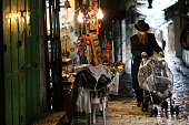 Hasidic man pushes a buggy in the Old City in Jerusalem on November 26 2014 in Jerusalem Israel Nine Israelis have been killed in a series of...
