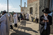 Hasidic pilgrims pray near the burial site of Rebbe Nachman of Breslov on September 14 2015 in Uman Ukraine Every year tens of thousands of Hasidim...