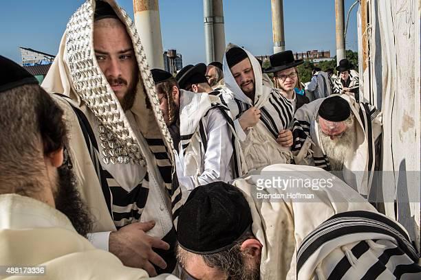 Hasidic pilgrims pray near the burial site of Rebbe Nachman of Breslov on September 14 2015 in Uman Ukraine Every year tens of thousands of Hasidim...