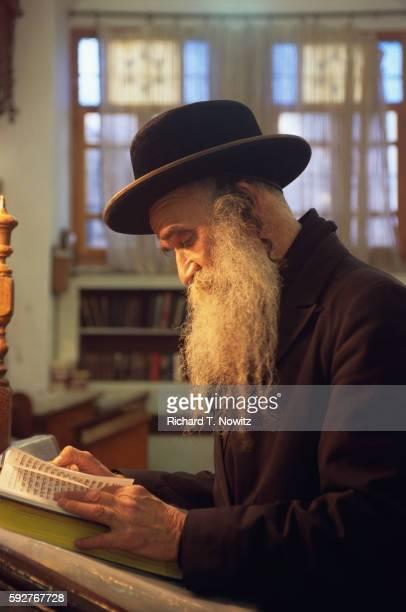 Hasidic Rabbi in Ancient Prayer House