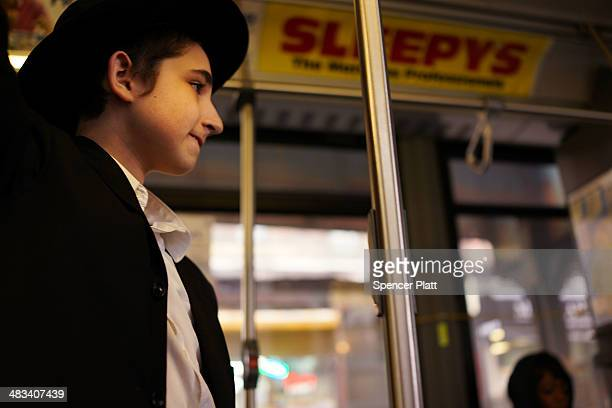 Hasidic teen rides the B46 bus on April 8 2014 in the Brooklyn borough of New York City The B46 bus which runs through parts of Crown Heights...