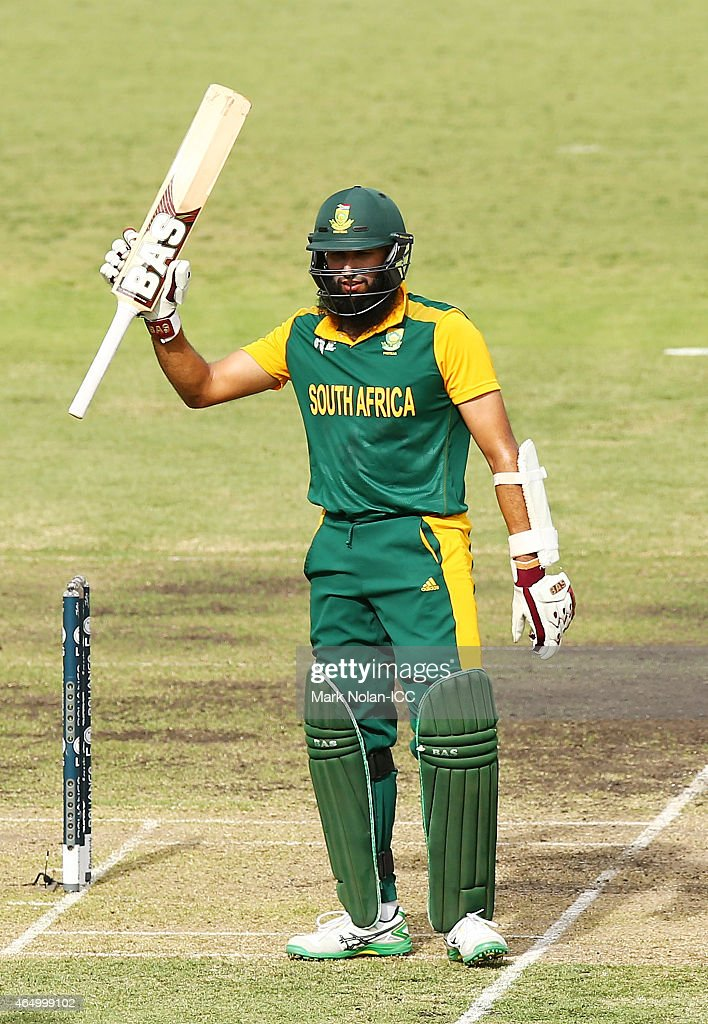 Hasim Amla of South Africa celebrates scoring a century during the 2015 ICC Cricket World Cup match between South Africa and Ireland at Manuka Oval on March 3, 2015 in Canberra, Australia.