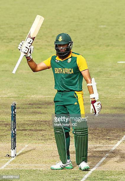 Hasim Amla of South Africa celebrates scoring a century during the 2015 ICC Cricket World Cup match between South Africa and Ireland at Manuka Oval...
