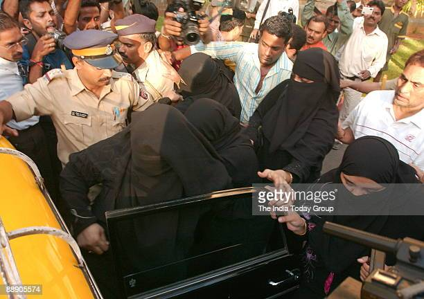 Hasina Parkar sister of fugitive mobster and India's most wanted criminal Dawood Ibrahim with four other burqaclad women appearing for anticipatory...