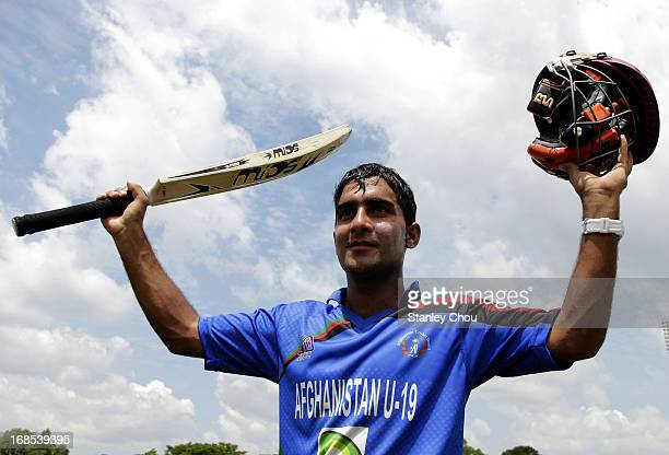 Hasmatullah Shaidi of Afghanistan celebrates after the 2013 Asian Cricket Council Under19 Elite Cup final match between Afghanistan and United Arab...