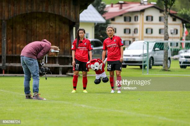 Hasret Kayikci and AnjaMaike Hegenauer of SC Freiburg carry 'Fuechsle' the mascot during the Allianz Frauen Bundesliga Club Tour on August 21 2017 in...