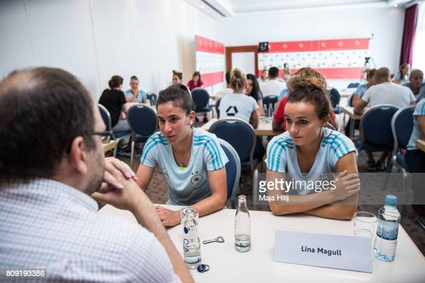 Hasret Kayikci and Lina Magull talk to the reporter during Germany Women's National Soccer Team Media Day on July 5 2017 in Heidelberg Germany