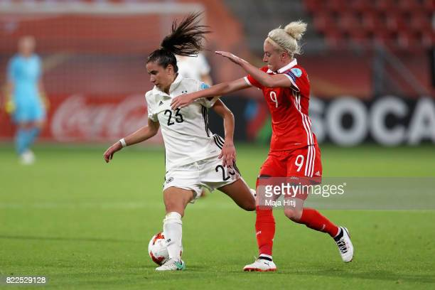 Hasret Kayikci of Germany and Anna Cholovyaga of Russia battle for possession during the Group B match between Russia and Germany during the UEFA...