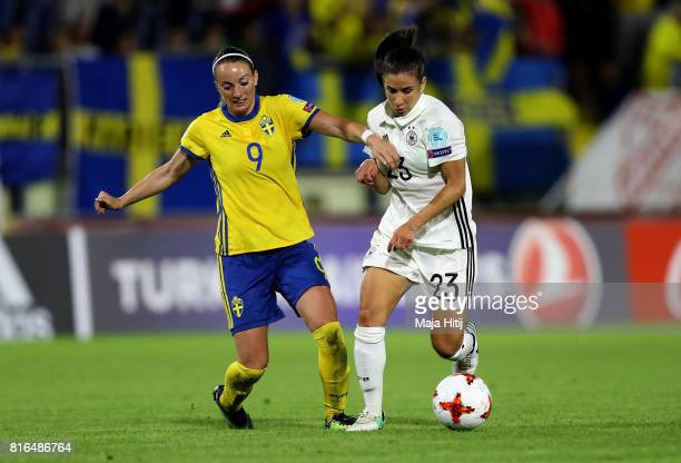 Hasret Kayikci of Germany and Kosovare Asllani of Sweden compete for the ball during the Group B match between Germany and Sweden during the UEFA...