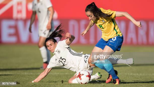 Hasret Kayikci of Germany and Luana Bertolucci Paixao of Brazil battle for the ball during the Women's International Friendly match between Germany...