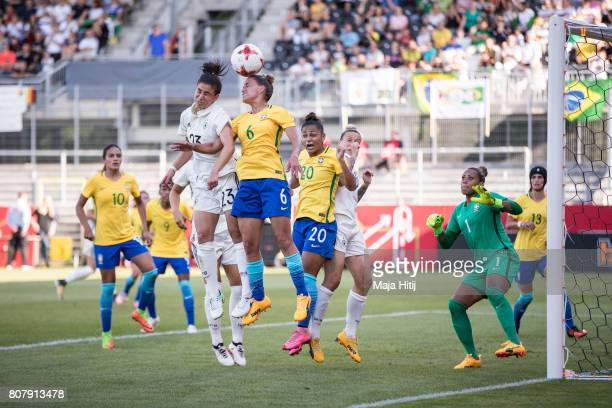 Hasret Kayikci of Germany and Tamires Cassia Dias Britto of Brazil battle for the ball during the Women's International Friendly match between...
