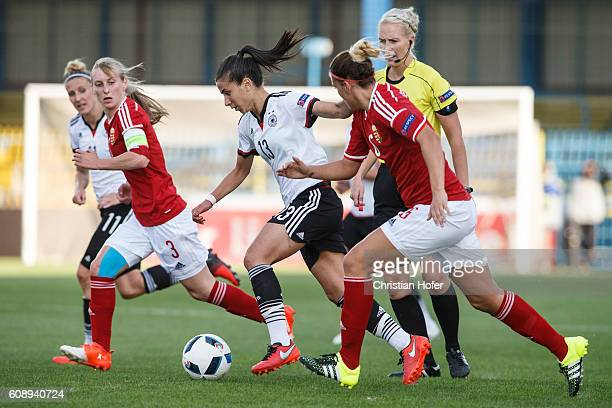 Hasret Kayikci of Germany competes for the ball with Henrietta Csiszar and Reka Demeter of Hungary during the UEFA Women's Euro 2017 Qualifier...