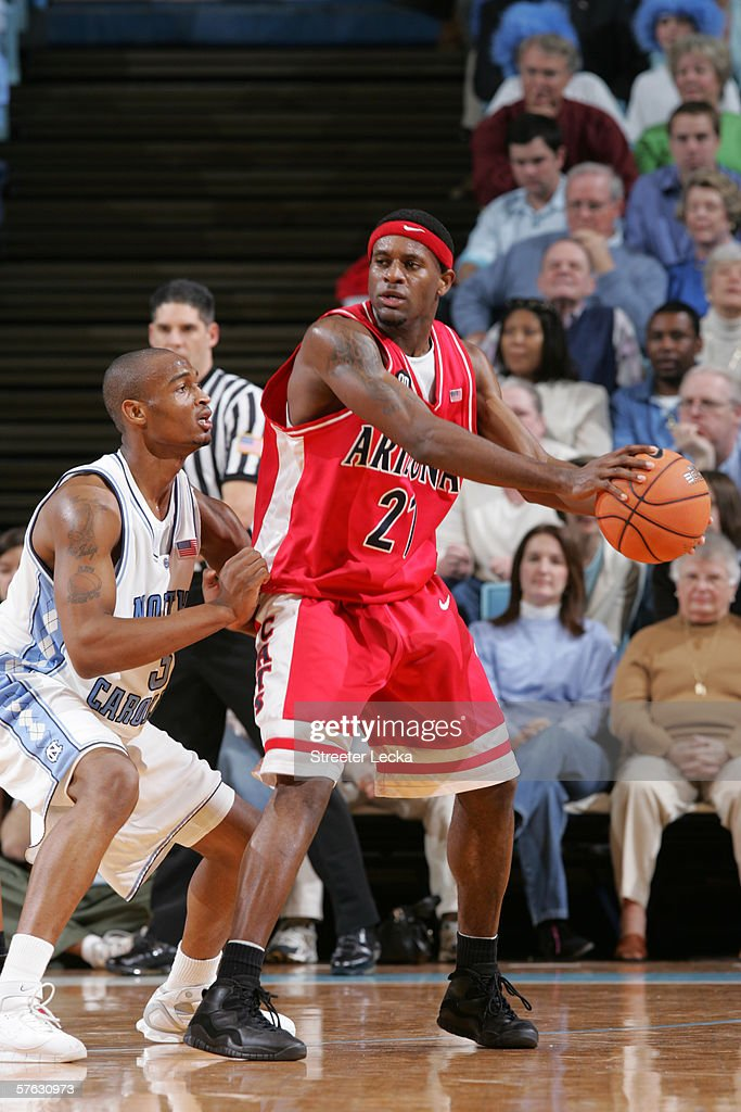 Hassan Adams #21 of the Arizona Wildcats posts up against Reyshawn Terry #3 of the University of North Carolina Tar Heels on January 28, 2006 at the Dean Smith Center in Chapel Hill, North Carolina. The Tar Heels won 86-69.