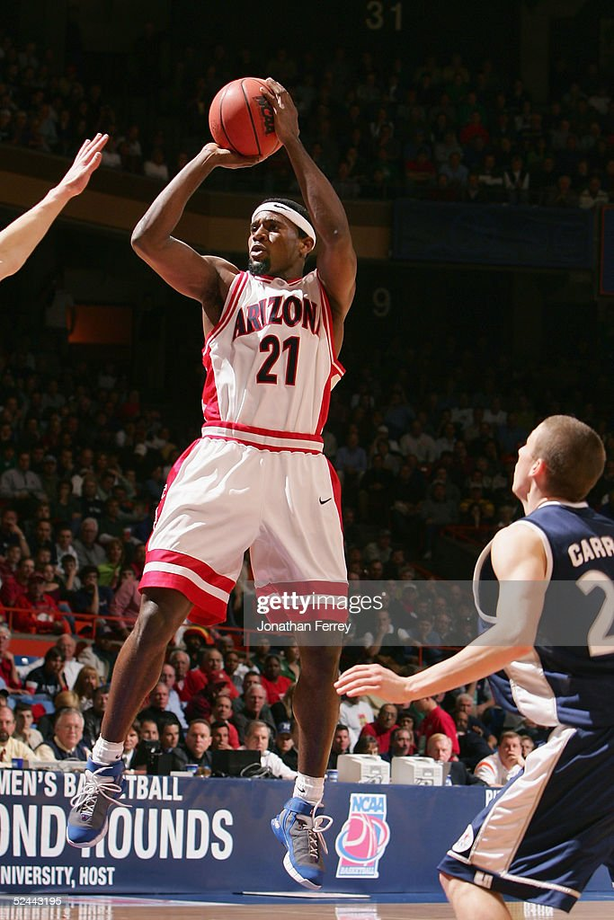 Hassan Adams of the Arizona Wildcats puts up a shot against the Utah State Aggies during the 2005 NCAA division 1 men's basketball championship...