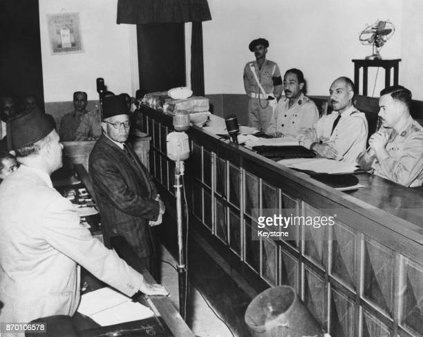 Hassan alHudaybi leader of the Muslim Brotherhood gives evidence in the trial of Mahmud Abdel Latif at the People's Court in Cairo Egypt November...