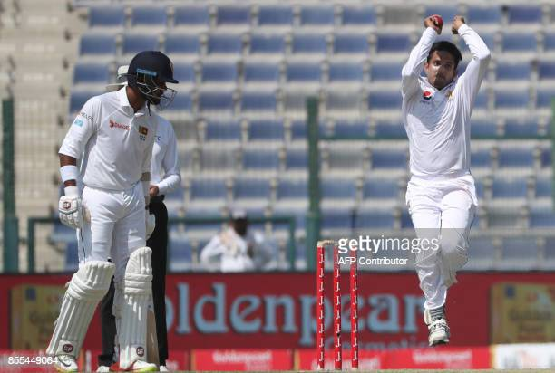 Hassan Ali of Pakistan bowls during the second day of the first Test cricket match between Sri Lanka and Pakistan at Sheikh Zayed Stadium in Abu...