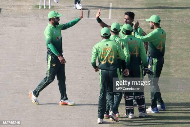 Hassan Ali of Pakistan celebrates after dismissing Niroshan Dickwella of Sri Lanka during the third one day international match between Pakistan and...