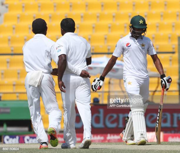 Hassan Ali of Pakistan walks after his dismissal during the fourth day of the first Test cricket match between Sri Lanka and Pakistan at Sheikh Zayed...