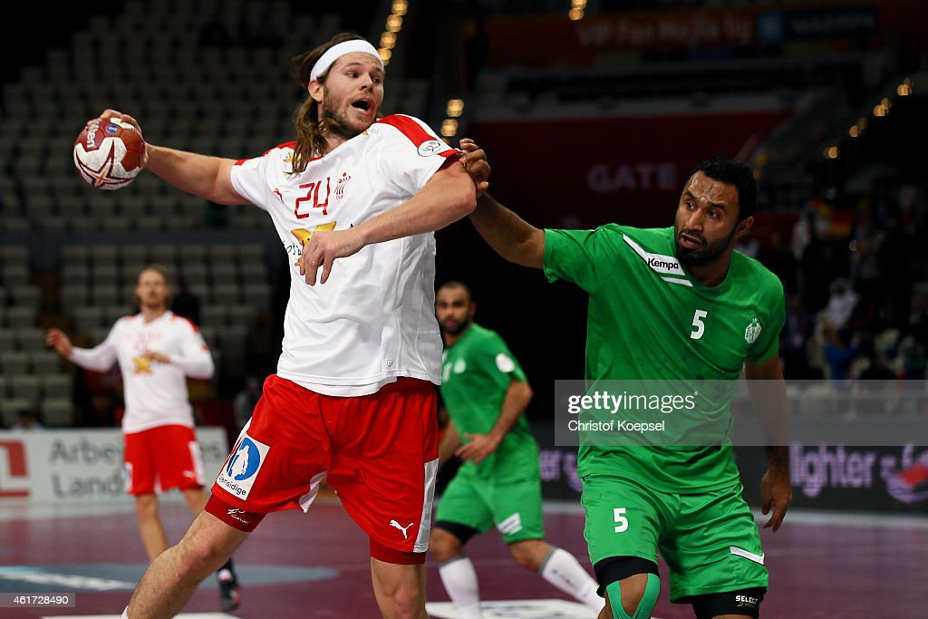 Hassan Aljanabi of Saudi Arabia defends against <a gi-track='captionPersonalityLinkClicked' href=/galleries/search?phrase=Mikkel+Hansen&family=editorial&specificpeople=5491088 ng-click='$event.stopPropagation()'>Mikkel Hansen</a> of Denmark (L) during the IHF Men's Handball World Championship group D match between Saudi Arabia and Denmark at Lusail Multipurpose Hall on January 18, 2015 in Doha, Qatar.