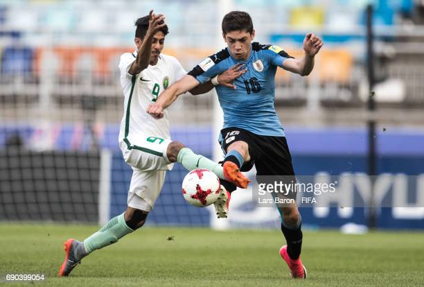 Hassan Alqayd of Saudi Arabia challenges Federico Valverde of Uruguay during the FIFA U20 World Cup Korea Republic 2017 Round of 16 match between...