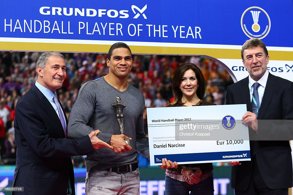 Hassan Moustafa, president of the International Handball Federation IHF (L), Mary, princess of Denmark (2nd R) and Kim Klastrup, representative of IHF partner and awarding sponsor Grundfos (R) honour <a gi-track='captionPersonalityLinkClicked' href=/galleries/search?phrase=Daniel+Narcisse&family=editorial&specificpeople=791032 ng-click='$event.stopPropagation()'>Daniel Narcisse</a> (2nd L) as the handballer of the year 2012 during the Men's Handball World Championship 2013 final match between Spain and Denmark at Palau Sant Jordi on January 27, 2013 in Barcelona, Spain.