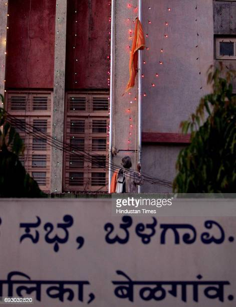 Hassan Mulla 50year old lowers a saffron flag from the Belgaum municipal Corporation building Karnataka government in view its celebrations over mark...