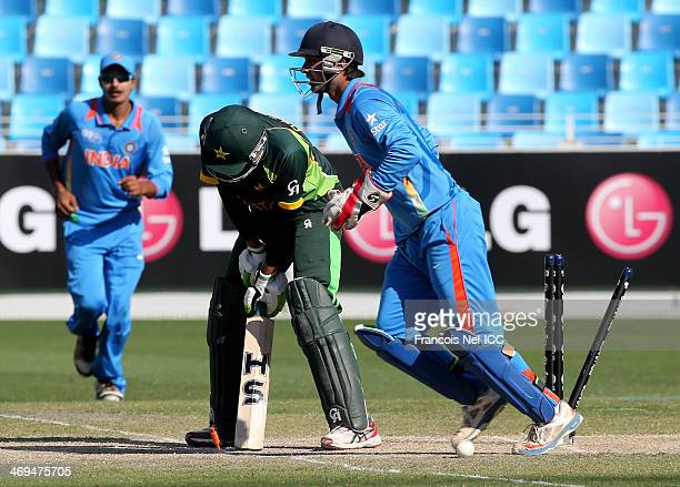 Hassan Razza of Pakistan reacts after being dismissed by Sarfaraz Khan of India during the ICC U19 Cricket World Cup 2014 match between India and...