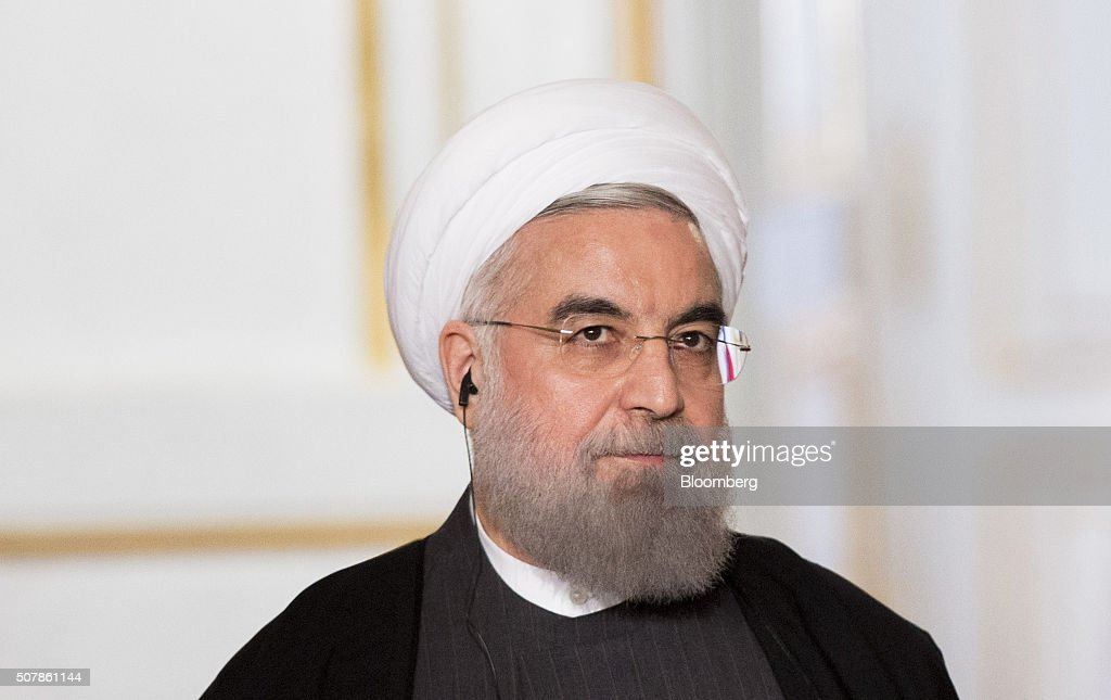 <a gi-track='captionPersonalityLinkClicked' href=/galleries/search?phrase=Hassan+Rouhani+-+Pol%C3%ADtico&family=editorial&specificpeople=641593 ng-click='$event.stopPropagation()'>Hassan Rouhani</a>, Iran's president, pauses during a joint press conference with Francois Hollande, France's president, not pictured, after a meeting at Elysee Palace in Paris, France, on Thursday, Jan. 28, 2016. French oil company Total SA will sign a contract with Iran to buy 150,000 to 200,000 barrels a day, chief executive officer Patrick Pouyanne said after meeting Rouhani in Paris, Agence-France Presse reported. Photographer: Christophe Morin/Bloomberg via Getty Images.