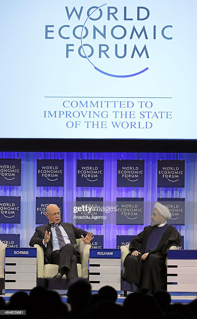 Hassan Rouhani (R) President of the Islamic Republic of Iran listens to Klaus Schwab (L), Founder and Executive Chairman of the World Economic Forum during the session 'Iran in the World' at the Annual Meeting 2014 of the World Economic Forum at the congress centre in Davos, January 23, 2014.