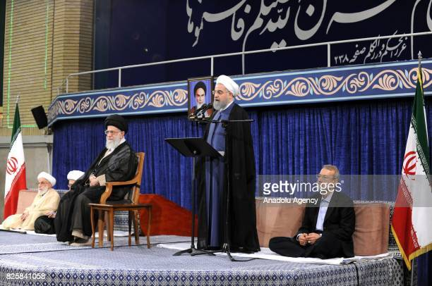 Hassan Rouhani who was reelected in presidential elections on May 2017 delivers a speech as Iranian Supreme Leader Ali Khamenei and Iranian...