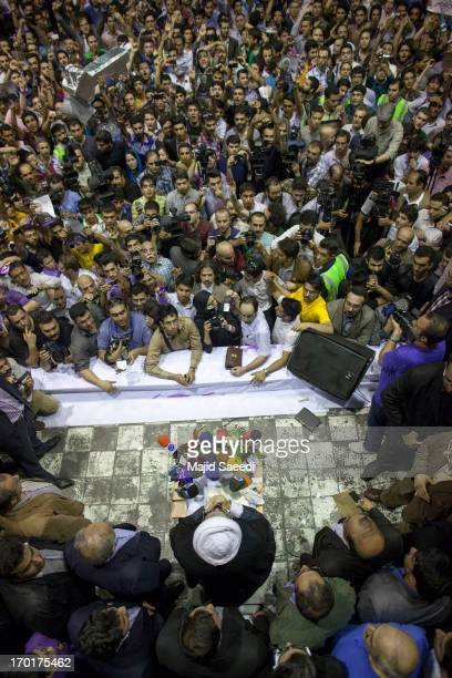 Hassan Rowhani a moderate Iranian presidential candidate and former top nuclear negotiator speaks to his supporters as he attends his campaign rally...