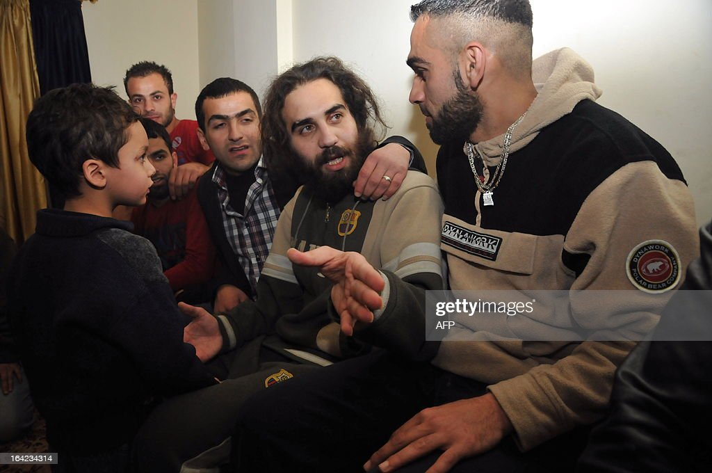 Hassan Srour, a Lebanese citizen who was captured by Syrian security forces after infiltrating the country to fight alongside rebel forces, is surrounded by relatives after his release in the Lebanese northern city of Tripoli on March 21, 2013. Srour is officially the only survivor of a group composed of young Sunni Lebanese and a Palestinians from Tripoli, in northern Lebanon, who tried to enter Syria in November.
