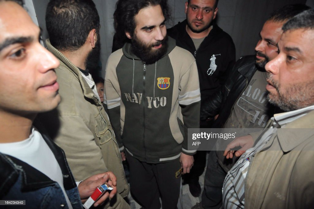 Hassan Srour (C), a Lebanese citizen who was captured by Syrian security forces after infiltrating the country to fight alongside rebel forces, is surrounded by relatives after his release in the Lebanese northern city of Tripoli on March 21, 2013. Srour is officially the only survivor of a group composed of young Sunni Lebanese and a Palestinians from Tripoli, in northern Lebanon, who tried to enter Syria in November.