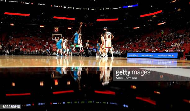 Hassan Whiteside of the Miami Heat and Dwight Howard of the Charlotte Hornets jump ball during a preseason game at American Airlines Arena on October...