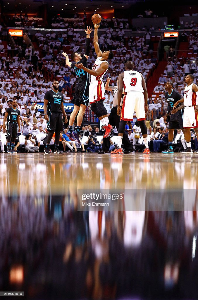<a gi-track='captionPersonalityLinkClicked' href=/galleries/search?phrase=Hassan+Whiteside&family=editorial&specificpeople=7068411 ng-click='$event.stopPropagation()'>Hassan Whiteside</a> #21 of the Miami Heat and <a gi-track='captionPersonalityLinkClicked' href=/galleries/search?phrase=Frank+Kaminsky&family=editorial&specificpeople=8685398 ng-click='$event.stopPropagation()'>Frank Kaminsky</a> III #44 of the Charlotte Hornets jump ball during Game Seven of the Eastern Conference Quarterfinals of the 2016 NBA Playoffs at American Airlines Arena on May 1, 2016 in Miami, Florida.