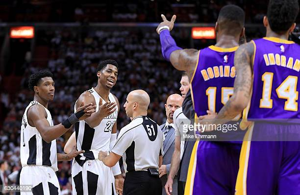 Hassan Whiteside of the Miami Heat and Thomas Robinson of the Los Angeles Lakers get into an argument during a game at American Airlines Arena on...