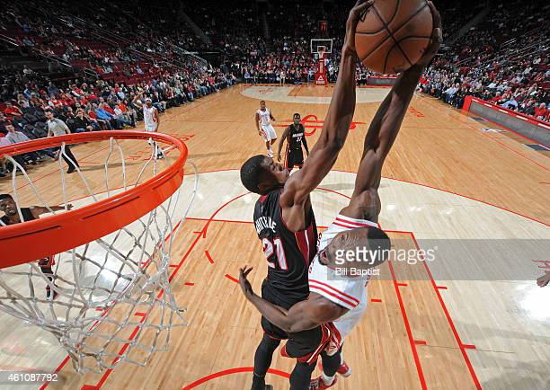 Hassan Whiteside of the Miami Heat blocks a shot against Joey Dorsey of the Houston Rockets during the game on January 3 2015 at the Toyota Center in...