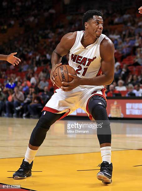 Hassan Whiteside of the Miami Heat drives to the basket during a preseason game against the Philadelphia 76ers at American Airlines Arena on October...