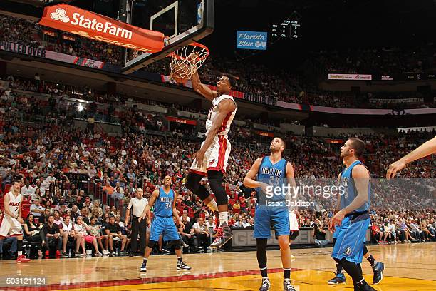 Hassan Whiteside of the Miami Heat dunks against the Dallas Mavericks on January 1 2016 at American Airlines Arena in Miami Florida NOTE TO USER User...