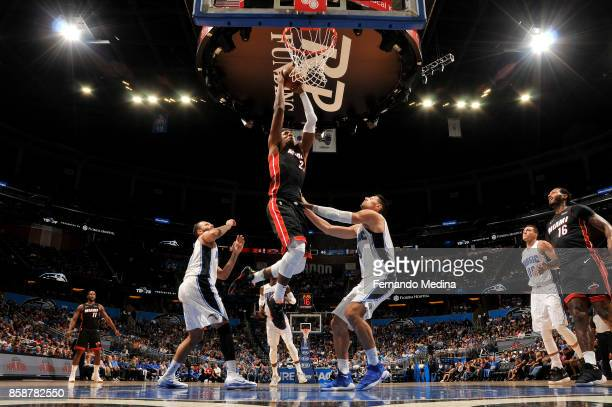 Hassan Whiteside of the Miami Heat dunks against the Orlando Magic during a preseason game on October 8 2017 at Amway Center in Orlando Florida NOTE...