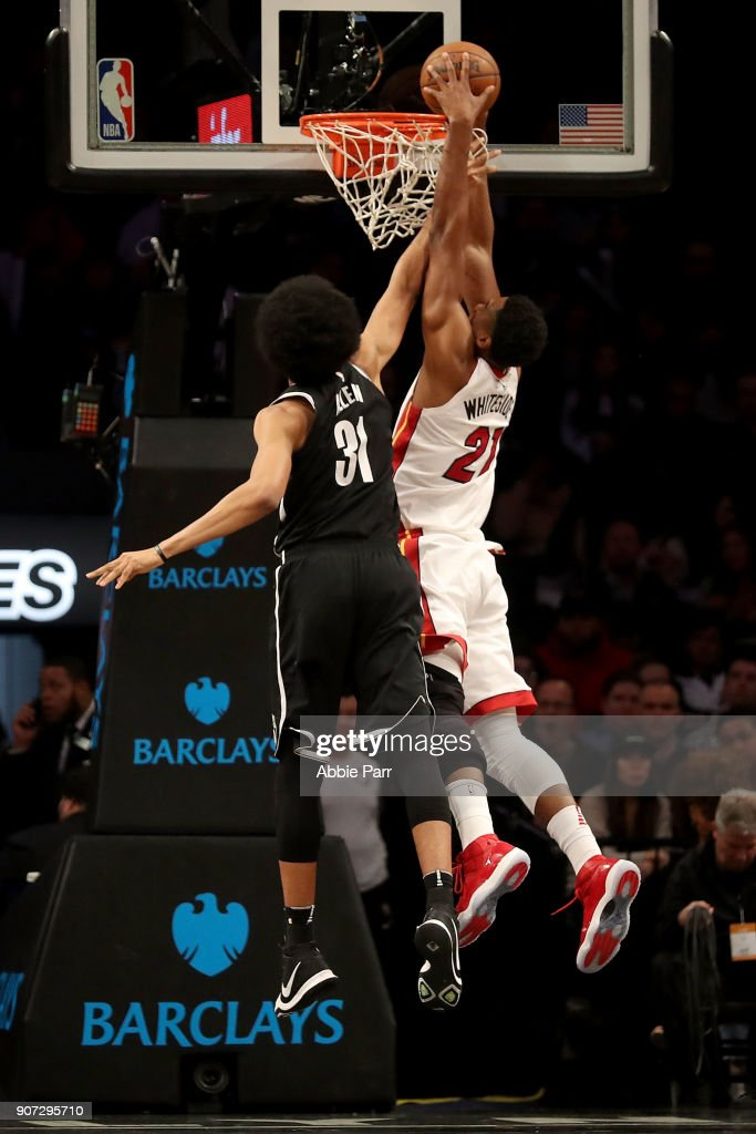 Hassan Whiteside #21 of the Miami Heat dunks the ball against Jarrett Allen #31 of the Brooklyn Nets in the second quarter during their game at Barclays Center on January 19, 2018 in the Brooklyn borough of New York City.