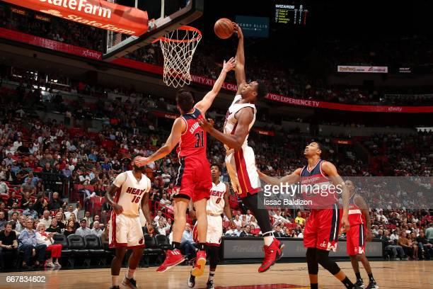 Hassan Whiteside of the Miami Heat goes for a dunk during the game against the Washington Wizards on April 12 2017 at AmericanAirlines Arena in Miami...